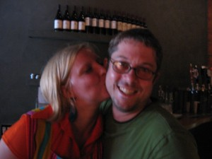 Employee Haley plants one on co-owner Jason!